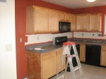 Kitchen - finishing the first coat of red
