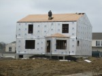 Back of the house; finishing touches for the plywood on the roof.  Windows are cut out.