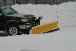 Emily's dad plowing the driveway