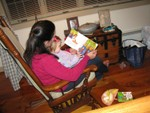 Lilly getting read to by Oma.  Lillian adores books.
